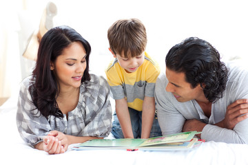 Affectionate family reading book together