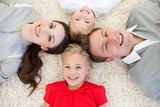 Happy family lying on the floor