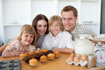 Happy family presenting their muffins