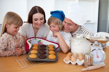 Merry family presenting their muffins