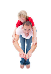 Smiling little boy enjoying piggyback ride with his father