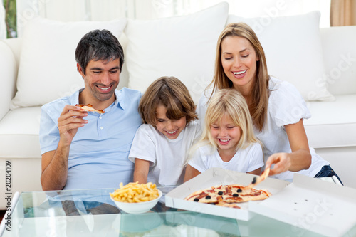 Positive family eating pizzas