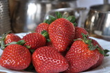 Juicy fresh strawberry on kitchen.