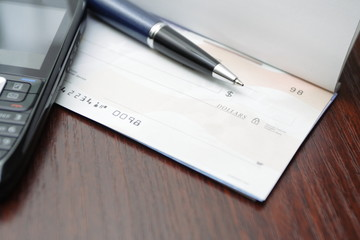 Business concept with check on a desk