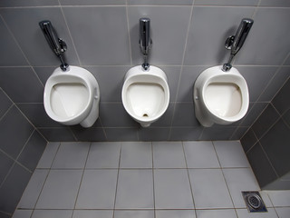 3 urinals in men's room