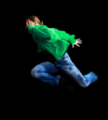 cool looking dancer posing on a black background.