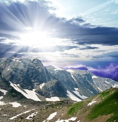 sparkle sun above a mountain chains