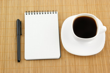 Blank pad of paper with pen and coffee