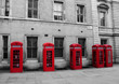Red telephone boxes on black and white