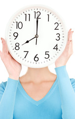 woman with big clock covering face