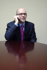 Business Man at Desk with Phone