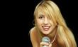 Blonde girl with naked shoulders singing karaoke