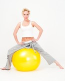 sportswoman sitting on a big fitness ball