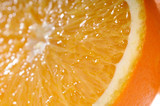 Juicy orange slice very close-up