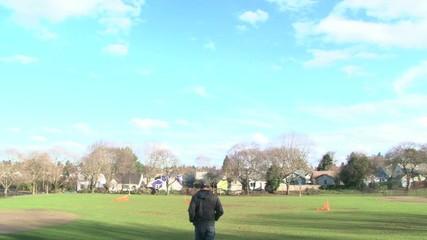 Man Walking Through Park