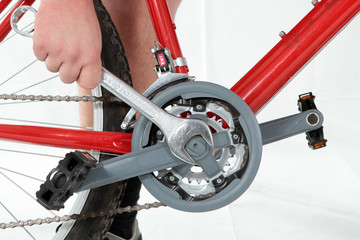reparing a bike with a wrench