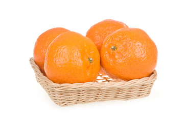 Ripe Tangerine Fruits in Basket Isolated on White