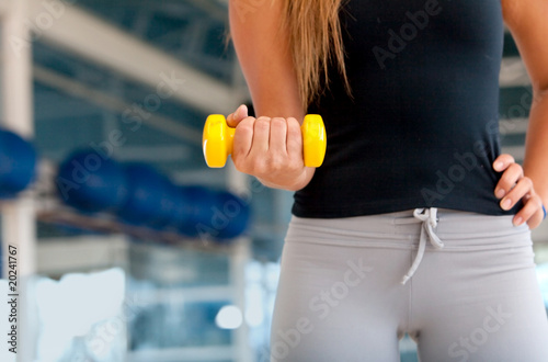 Woman torso with free weight