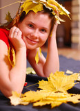 portrait of smiling girl with yellow leaves