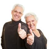 Fototapety Senioren zeigen mit Daumen nach oben
