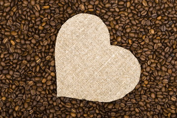 Sackcloth heart on coffee beans background