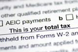 Focus on the total tax in the income tax return poster