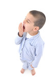 Little cute boy wearing pajamas yawning poster