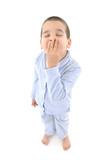 Little cute boy wearing pajamas yawning  . poster