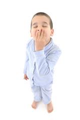 Little cute boy wearing pajamas yawning  .