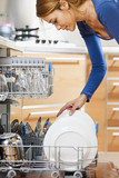 woman using dishwasher poster