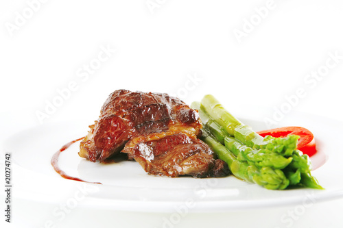 beef meat served on white