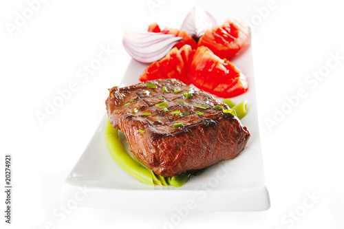 roast meat served with tomato