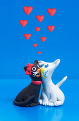 Two sweet plasticine black and white cats in love with copyspace