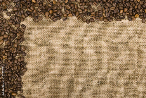 Fotobehang Koffiebonen Coffee beans and sackcloth background