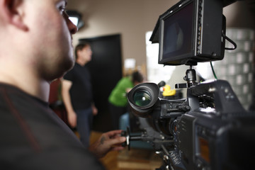 Cameraman operating digital cinema camera