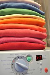 Rainbow laundry on washing machine