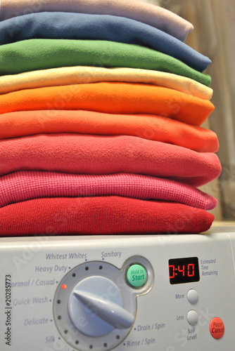 Rainbow laundry on washing machine