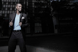 Fototapety Handsome African American man in the city at night