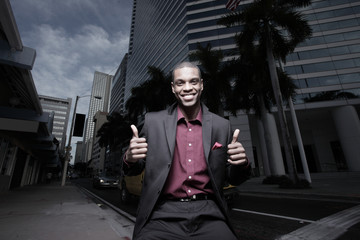 Businessman showing two thumbs up