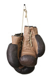 Old boxing gloves hanging on a lace - 20303305