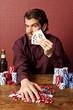 man winning at poker
