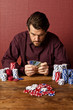 man playing poker with credit cards