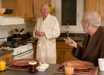 mature gay couple having breakfast