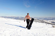 Snowboarder topless walk up on the mountain