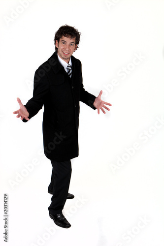 young business man wearing a coat