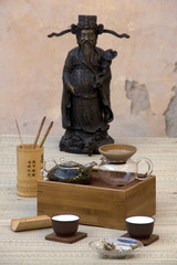Traditional chinese tea set with statue