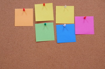 Coloured memory paper - reminder on a noticeboard.