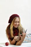 Junge Frau mit ebook Reader und Apfel poster