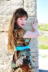pretty woman near old wall