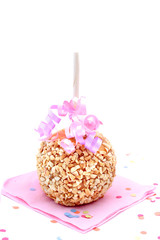 Caramel candy apple with peanuts